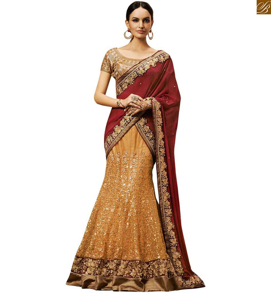 GEORGEOUS MAROON AND BEIGE COLOURED EMBROIDERED DESIGNER SAREE WITH A HEAVY CREAM BLOUSE BY STYLISH BAZAAR