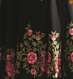 This dress has Green and Pink colored heavy floral embroidery work and beautiful copper color patch work on sleeves. The churidar bottom is of black color and made of santoon. The Pink chiffon dupatta comes with lace border line