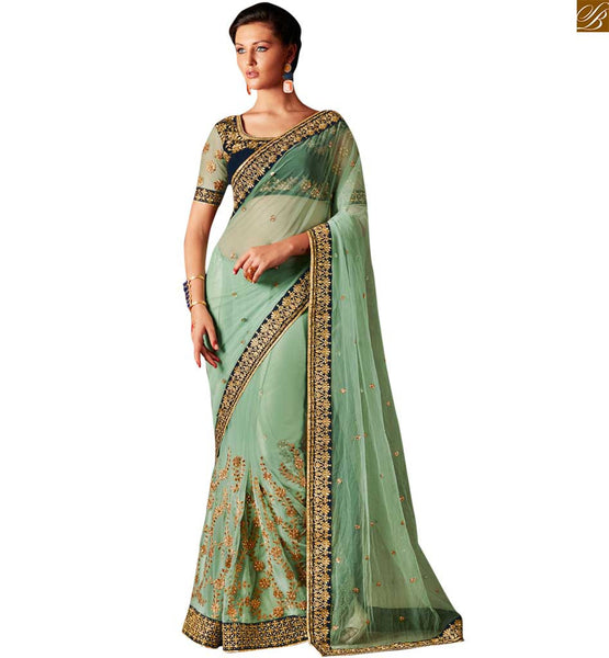 STYLISH BAZAAR ELEGANT DESIGNER GREEN NET DESIGNER SAREE WITH A VELVET BLOUSE ANRF51