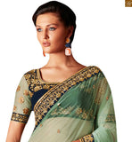 FROM THE STYLISH BAZAAR ELEGANT DESIGNER GREEN NET DESIGNER SAREE WITH A VELVET BLOUSE ANRF51