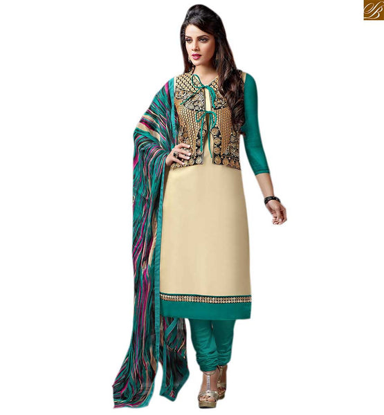 Indian salwar kameez designs of beautiful punjabi style suits cream cotton and art-silk heavy embroidered jacket style salwar kameez with green cotton bottom Image