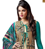 Look pleasing in this eclectic attractive indian salwar kameez designs of beautiful punjabi style suits for indian womens day to day wear cream cotton and art-silk heavy embroidered jacket style salwar kameez with green cotton bottom. Green chiffon printed dupatta is also included photo