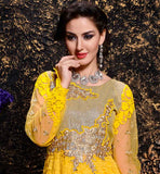 EYE-CATCHING YELLOW COLOR BRASSO AND NET FABRIC ANARKALI WITH SALWAR AND DUPATTA  GORGEOUS YELLOW IN BRASSO AND NET ANARKALI SUIT COMES IN  FLOOR LENGTH AND BANDGALA STYLE, THIS DRESS BEAUTIFULLY DECORATED IN SILVER FLORAL EMBROIDERY PATCH WORK ON NECK AND SLEEVES