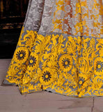 GORGEOUS YELLOW IN BRASSO AND NET ANARKALI SUIT COMES IN  FLOOR LENGTH AND BANDGALA STYLE, THIS DRESS BEAUTIFULLY DECORATED IN SILVER FLORAL EMBROIDERY