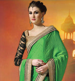GLAMOROUS GREEN SATIN CHIFFON AND NET SARI WITH GOLDEN AND BLACK BLOUSE DECORATED WITH BEAUTIFUL STONE WORK ON ALL OVER THE PALLU AND COPPER COLOR BEAUTIFUL BORDER WORK WITH TWO SIDE WEAVING