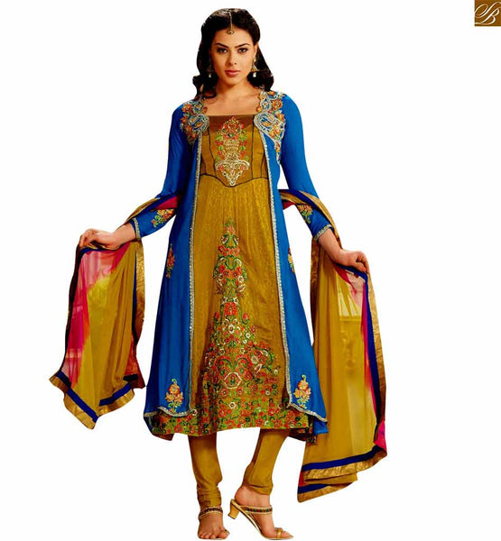 Beige and blue designer jacket style salwar kameez beige and blue georgette salwar kameez with zari and floral embroidered jacket. This dress has zari and embroidered patch work Image