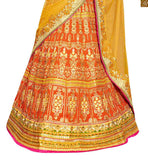 FROM THE HOUSE  OF STYLISH BAZAAR BEWITCHING ORANGE EMBROIDERED LEHENGA WITH GREEN BLOUSE RTHYD6809