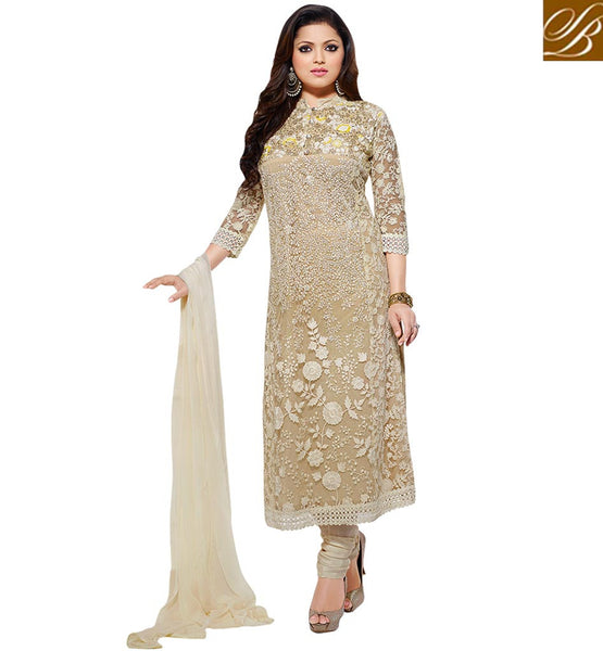 TRENDY BOLLYWOOD CELEBRITIES IN SALWAR KAMEEZ MADHUBALA CREAM NET DRESS WITH LIGHT CHIKOO INNER