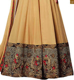 Image of Beige georgette heavy embroidered jacket type anarkali salwar kameez with beige santoon bottom
