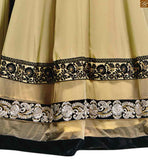 Image of Beige georgette heavy embroidered kameez with velvet border on lower part and beige santoon bottom