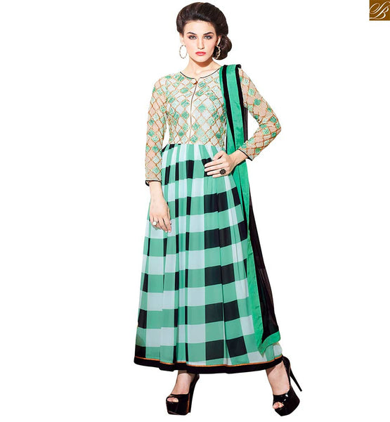 TEMPTING NEW COLOUR COMBINATION FOR SALWAR KAMEEZ CHECKS PRINT AND UNIQUE EMBROIDERY Off White, Green And Black Georgette Embroidered Top With Black Shalwar. Pure Chiffon Dupatta and Astar included