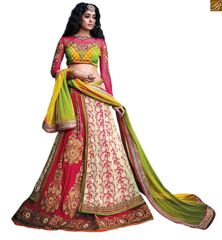 A STYLISH BAZAAR PRESENTATION BEWITCHING CREAM AND PINK COLLOURED GHAGRA COMPLEMENTED WITH A TRIUNE BLOUSE RTSEL807