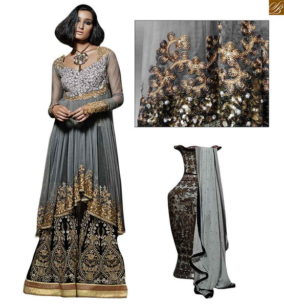 Grey gown style dress with silk velvet plazzo grey net and banglori-silk new trendy looking salwar kameez. Top at heavy embroidery work and diamond work on neck line Image