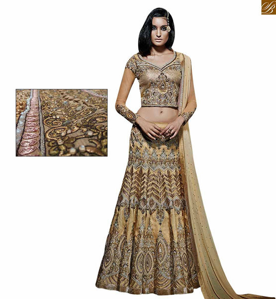 Bridal wear beige heavy lahenga with silk blouse beige pure-silk prince cut neck line designer lehanga choli. Silk blouse with sequins. Top at heavy floral embroidery sequence work Image