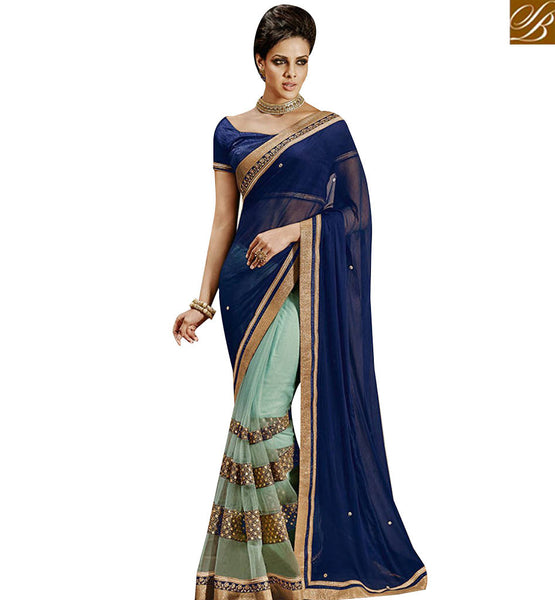 STYLISH BAZAAR SPLENDID SKY BLUE NET HAVING WELL EMBROIDERED WITH NAVY BLUE CHIFFON PALLU NKEVR9022