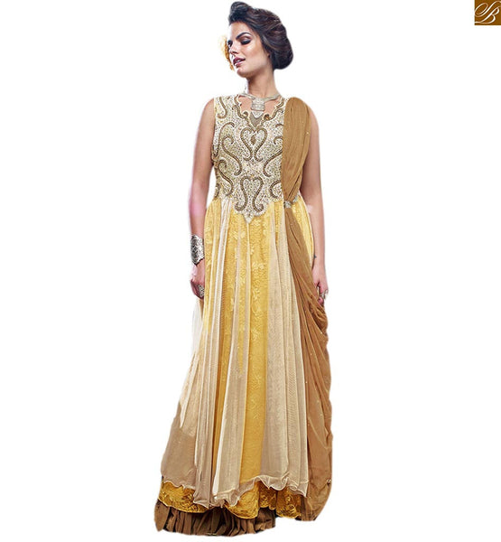 ALLURING DESIGNER GOWNS ONLINE SHOPPING STYLISH WOMEN WEAR SUITABLE FOR PARTY WEAR DRESS-UP, CREAM, YELLOW & BROWN NET BRASSO HEAVY EMBROIDERED DESIGNER GOWN, NECK BEAUTIFIED WITH COLORFUL DIAMONDS