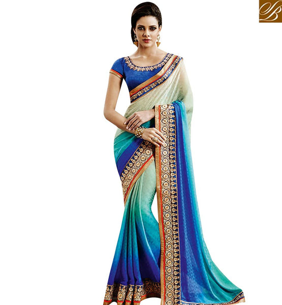 STYLISH BAZAAR APPEALING BLUE SHADED JACQUARD WITH HEAVY EMBROIDERY WORK ON BORDER NKEVR9026
