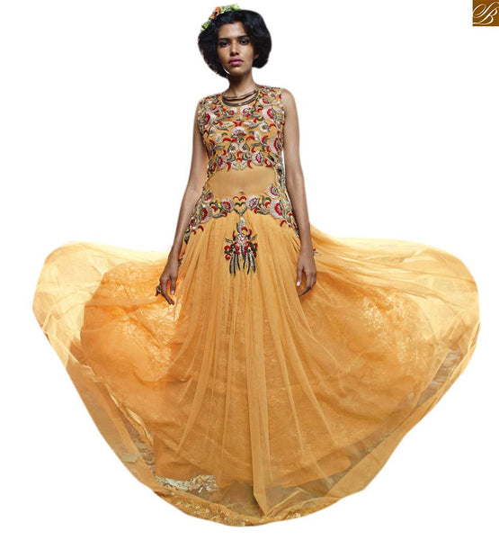 IRRESISTIBLE BEAT INDIAN EVENING GOWNS COLLECTION CONVENIENT FOR WOMEN WANT TO BE IN THE MAINSTREAM AT EVERY OCCASION AND FESTIVALS  MUSTARD NET BRASSO PARI STYLE FLORAL PATTERNED NECK LINE.A PERFECT FIT  EVENING GOWN FOR OCCASIONS THIS SEASON