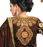 The bottom is of brown color and is made up of santoon fabric. Matching chiffon dupatta comes with lace border Image