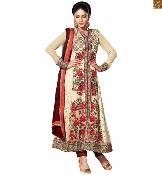 Cream colored georgette designer salwar kameez cream georgette and jacquard floral embroidered and stone worked party wear salwar kameez Image