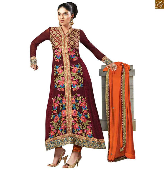 Maroon colored stylish georgette designer salwar kameez maroon georgette and jacquard salwar kameez with heavy floral embroidery work. This salwar kameez is of shervani style which makes it look beautiful Image