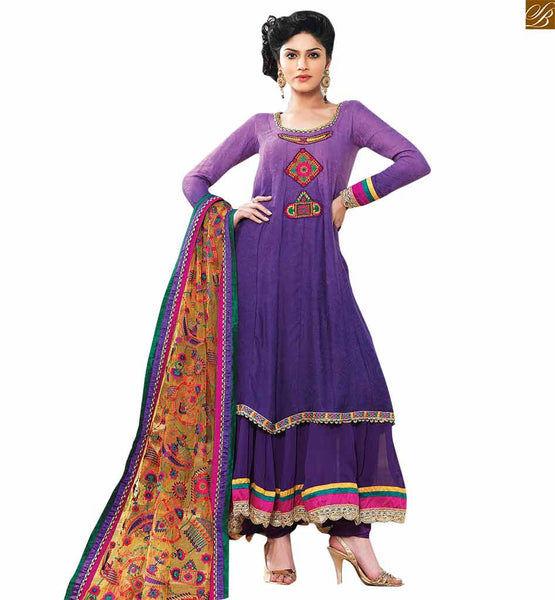 Shaded purple and blue designer salwar kameez this salwar kameez is shaded combination of purple and blue color. Its made up of georgette. This dress has floral embroidered patch work on neck side Image