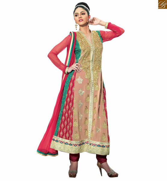 Designer heavy pink and cream salwar kameez this salwar kameez is a combination of pink and cream colored georgette. It has zari, resham embroidered and stone work in sherwani style Image