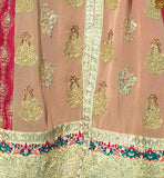 The embroidery work extends on the back side as well. Lace border work is at the middle portion of the fron Pic