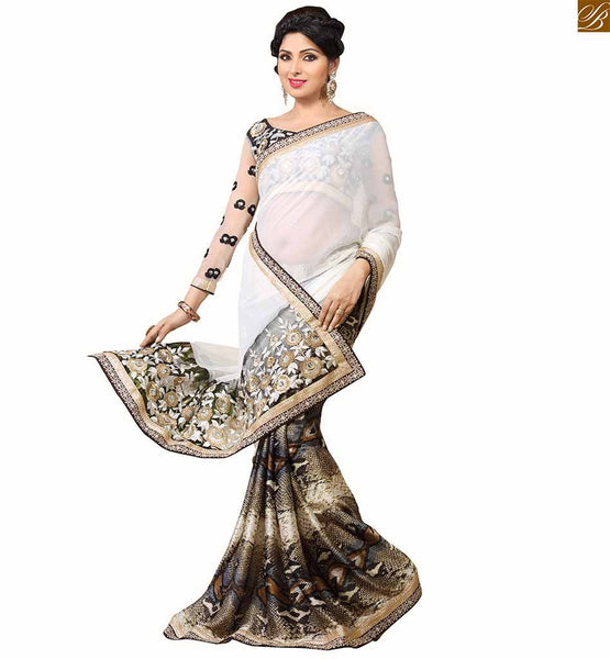 Blouse neck designs and long full sleeves for saree models 2015 snak skin type patterns abstract print on lower part & floral embroidery work on pallu with border line saree designs. Floral embroidery worked blouse.