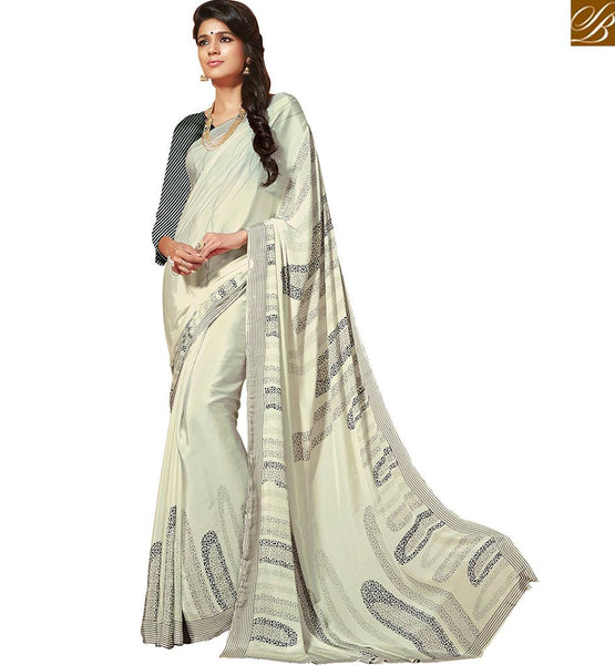 A STYLISH BAZAAR APPEALING CREPE SILK PRINTED SAREE RTDVM9309