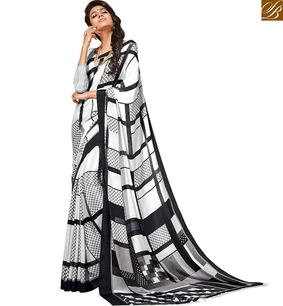 A STYLISH BAZAAR PRESENTATION ALLURING WHITE DESIGNER SARI WITH BLACK ABSTRACT PRINTS RTDVM9311