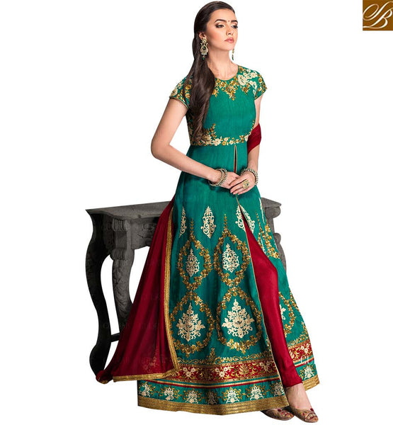 STYLISH BAZAAR APPEALING GREEN SILK DESIGNER ANARKALI SALWAR KAMEEZ HAVING RED BOTTOM AND DUPATTA GLZR1707
