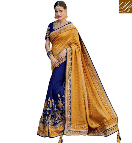 STYLISH BAZAAR BLUE GEORGETTE AND MUSTARD JACQUARD SILK DESIGNER BRIDAL WEAR EMBROIDERED SAREE KMVSA50