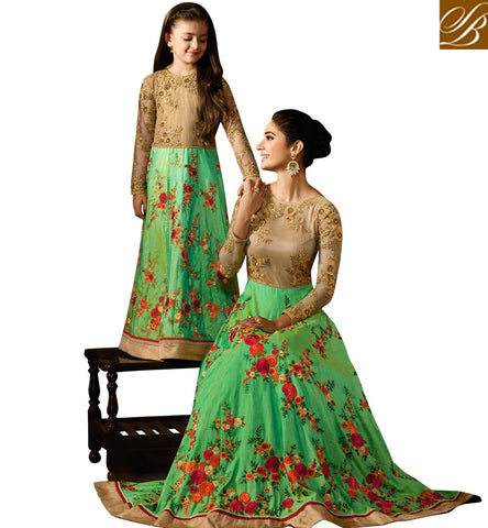 STUNNING GREEN AND BEIGE EMBROIDERED SILK HAVING WELL FRORAL WORK PARTY WEAR ANARKALI SUIT KRM8056