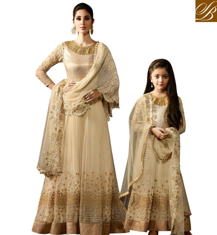 ATTRACTIVE CREAM NET WELL DESIGNED PARTY WEAR ANARKALI SALWAR SUIT WITH GOOD NECK DESIGN KRM8059