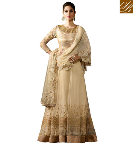 STYLISH BAZAAR ATTRACTIVE CREAM NET WELL DESIGNED PARTY WEAR ANARKALI SALWAR SUIT WITH GOOD NECK DESIGN KRM8059