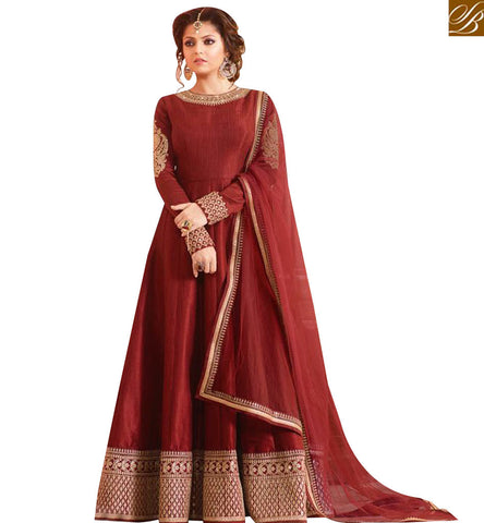 STYLISH BAZAAR STUNNING MAROON SILK DESIGNER DRASHTI DHAMI PARTY WEAR ANARKALI SUIT HAVING WELL BORDER WORK LTNT97007