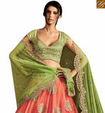 FROM STYLISH BAZAAR REMARKABLE GREEN SILK AND PEACH NET DESIGNER LEHENGA SAREE WITH GREEN EMBROIDERED PALLU NKNET5056