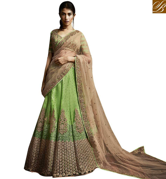 STYLISH BAZAAR UNIMAGINABLE GREEN SILK AND NET PARTY WEAR DESIGNER LEHENGA SAREE WITH BEIGE NET PALLU NKNET5058