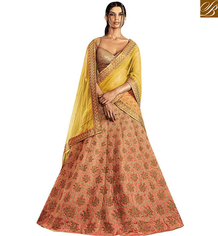 STYLISH BAZAAR GRACEFUL PEACH ITALIAN SILK WITH ALL OVER HEAVY EMBROIDERY WORK LEHENGA SAREE WITH YELLOW NET PALLU NKNET5062