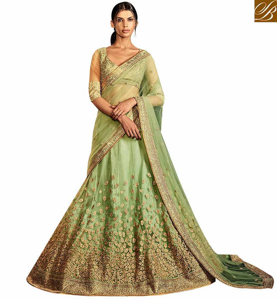 ENTICING PISTA GREEN SILK AND NET LEHENGA SAREE WITH PERSONIFIED EMBROIDERY NKNET5064