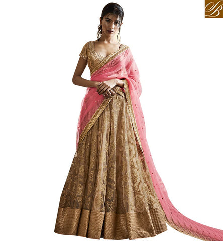 STYLISH BAZAAR MAGNIFICENT BEIGE NET LEHENGA SAREE HAVING ALL OVER HEAVY EMBROIDERY WITH PINK NET PALLU NKNET5065