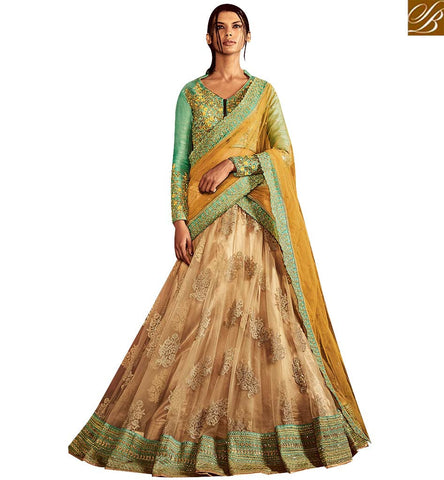STYLISH BAZAAR STUNNING BEIGE NET AND GREEN SILK LEHENGA SAREE CONTAIN HEAVY EMBROIDERY AND LACE BORDER NKNET5066
