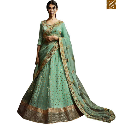 STYLISH BAZAAR PHENOMENAL PISTA GREEN NET AND SILK DESIGNER LEHENGA SAREE WITH MATCHING NET PALLU NKNET5068