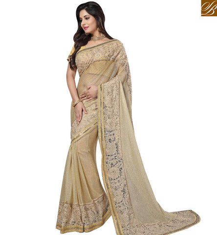 STYLISH BAZAAR WONDERFUL BEIGE NET HAVING WELL EMBROIDERY PARTY WEAR AMYRA DASTUR SAREE WITH LACE WORK MHAM4213