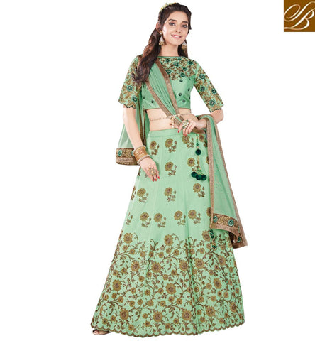 STYLISH BAZAAR BUY MARVELLOUS GREEN RAW SILK HAVING FLORAL WORK PARTY WEAR LEHENGA FROM STYLISH BAZAAR MHMMY7009