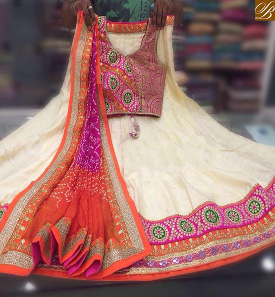 STYLISH BAZAAR GOOD LOOKING CREAM MANIPURAM SILK LEHENGHA CHOLI EMBROIDERY FLOWER AND LACE BORDER WITH DUPATTA ORANGE AND PINK COLOR SB010