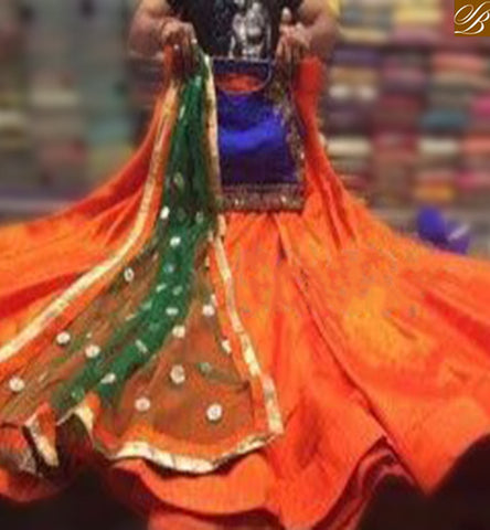 STYLISH BAZAAR CELEBRATE GARBA FESTIVAL WITH THIS ORANGE BLUE TAPETA SILK CHANIA CHOLI WITH GREEN COLOUR DUPPTTA HAVING EMBROIDERY ON CHOLI SB01