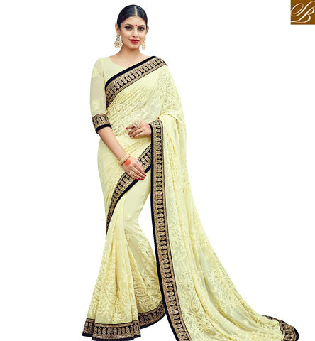 STYLISH BAZAAR INVITING MUSTARD GEORGETTE WELL EMBEDDED PARTY WEAR SAREE WITH BLACK LACE BORDER SLMN3608