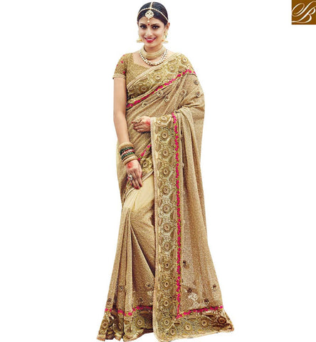 STYLISH BAZAAR BEWITCHING BEIGE NET DESIGNER PARTY WEAR SAREE HAVING SEQUENCE AND JARI DIAMOND WORK SLMN3613